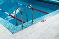 Swimming pool ladder in fitness club with stairs Royalty Free Stock Photos