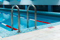 Swimming pool ladder in fitness club with stairs Stock Photo