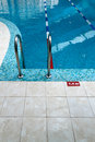 Swimming pool ladder in fitness with stairs Royalty Free Stock Photography