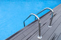 Swimming pool ladder horizontal photo of a with blue water Stock Photography