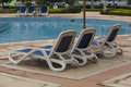 Swimming Pool Lounge Chairs Stock Photo