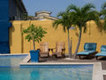 Swimming pool and loungers in the caribbean island of curacao Royalty Free Stock Photos