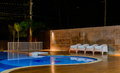 Swimming pool at a luxury Caribbean, tropical resort at night, dawn time. Royalty Free Stock Photo