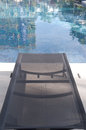 Swimming pool luxury home with chair in china Royalty Free Stock Photography