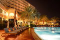The swimming pool at luxury hotel in night illumination ajman uae Stock Image