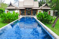 Swimming pool at luxury traditional villa Stock Photography