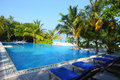 Swimming pool in maldives beach the near the Royalty Free Stock Photography