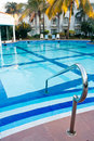 Swimming pool in morning resort Royalty Free Stock Photos