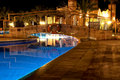 Swimming pool by night Stock Photo