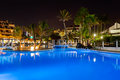 Swimming pool at night Stock Photos