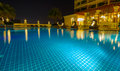 Swimming pool with night illumination in luxury hotel thailand Stock Images