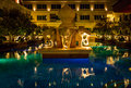 Swimming pool with night illumination in luxury hotel thailand Royalty Free Stock Image