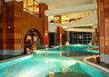 Swimming pool at night in modern hotel Stock Photography