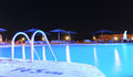 Swimming pool at night scenic view of illuminated Royalty Free Stock Photos