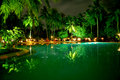 Swimming pool by night on a tropical location in maldives Royalty Free Stock Photos