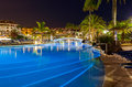 Swimming pool at night vacation background Stock Photos
