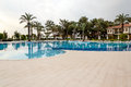 Swimming pool with nobody in resort at early morning Royalty Free Stock Photo