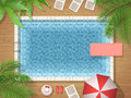 Swimming pool and palm top view Royalty Free Stock Photo