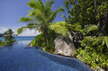 Swimming pool and palm trees of the Banyan Tree Hotel, Anse Intendance, Mahe`, Seychelles Royalty Free Stock Photo