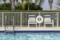 Swimming pool and palms in south florida Royalty Free Stock Photos