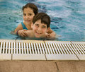 Swimming pool piggyback Stock Photography