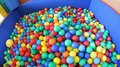 Swimming pool with plenty of colorful plastic balls large Royalty Free Stock Image