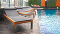 Swimming pool with relax chairs luxury Stock Photography