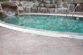 Swimming pool with a rock slide. Pool with rock slide without people Royalty Free Stock Photo