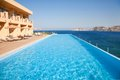 Swimming pool on sea resort grab bars ladder in the blue Stock Image
