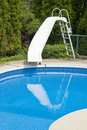 Swimming Pool with a Slide Royalty Free Stock Photo