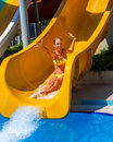 Swimming pool slides for children on water slide at aquapark. Royalty Free Stock Photo