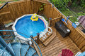 Swimming pool small in a backyard with a wooden deck Stock Photography