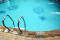 Swimming pool with stainless ladder Stock Images