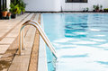 Swimming pool with stair in city Stock Image
