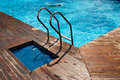 Swimming pool with stair and wooden floor Stock Photo