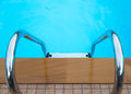 Swimming pool with stairs on background Stock Photos