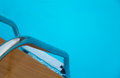 Swimming pool with stairs on background Royalty Free Stock Photography