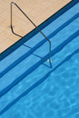 Swimming pool; steps and rail Stock Photo