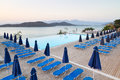 Swimming pool with sunbeds at Mirabello Bay Royalty Free Stock Photo