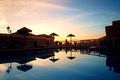 Swimming pool at sunset Royalty Free Stock Photo