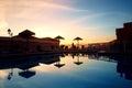 Swimming pool at sunset Royalty Free Stock Photo