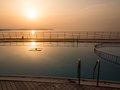 Swimming pool at sunset near the sea Royalty Free Stock Image
