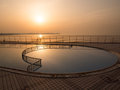 Swimming pool at sunset near the sea Royalty Free Stock Photos