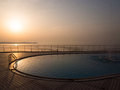 Swimming pool at sunset near the sea Royalty Free Stock Photo