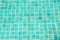 Swimming pool tiles underwater useful as background Stock Photo