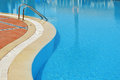 Swimming pool in touristic resort during summer time Stock Photography