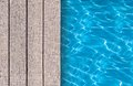 Swimming pool and wooden deck ideal for backgrounds Stock Images
