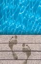 Swimming pool and wooden deck ideal for backgrounds Royalty Free Stock Photos