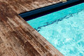 Swimming pool with wooden floor Royalty Free Stock Image