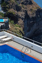 Swimming pools and hotels on the caldera in santorini blue greece Stock Photos